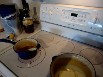 fruit in saucepan with sugar, water, lemon, brandy